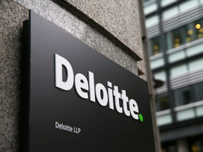 A Deloitte logo is pictured on a sign outside the company's offices in London on September 25, 2017.