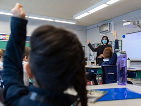 The EMSB showed off their newly installed air purifiers at Pierre Elliott Trudeau Elementary School in Montreal on Monday January 11, 2021. The HEPA filter hangs from the wall in the background while principal Tanya Alvarez takes over a class at the elementary school.