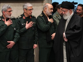 In this file handout picture provided by the office of Iran's Supreme Leader Ayatollah Ali Khamenei on January 9, 2020 shows Khamenei (R) greeting newly-appointed commander of the Quds Force of the Islamic Revolutionary Guard Corps Esmail Qaani (L), Iranian Armed Forces Chief of Staff Major General Mohammad Bagheri (C), and Iranian Islamic Revolutionary Guard Corps (IRGC) Chief Commander Hossein Salami, during a mourning ceremony in Tehran for slain top general Qasem Soleimani.