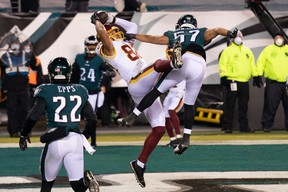 Washington Football Team tight end Logan Thomas (82) makes a touchdown catch past Philadelphia Eagles linebacker T.J. Edwards (57) during the second quarter at Lincoln Financial Field.   Washington won 20-14 to become the final team to qualify for the playoffs.