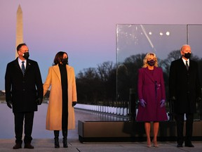 From left to right: Doug Emhoff, Vice-President-elect Kamala Harris, Dr. Jill Biden and President-elect Joe Biden at a memorial for victims of the coronavirus pandemic at the Lincoln Memorial on the eve of the presidential inauguration on Jan. 19, 2021 in Washington, D.C.