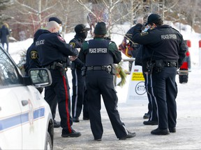 Calgary police and bylaw officers patrolled Bowness Park for crowed control and social distancing in Calgary on Wednesday, Dec. 30, 2020.