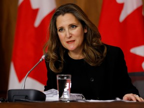Deputy Prime Minister and Minister of Finance Chrystia Freeland speaks to news media before unveiling her first fiscal update, the Fall Economic Statement 2020, in Ottawa, Nov. 30, 2020.