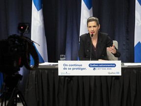 Quebec Deputy premier and Public Security Minister Genevieve Guilbault speaks at a news conference on the COVID-19 pandemic, Thursday, January 7, 2021 at the legislature in Quebec City. Guilbault outlined the rules as a curfew will be imposed on Saturday Jan. 9 from 8 p.m. to 5 a.m.