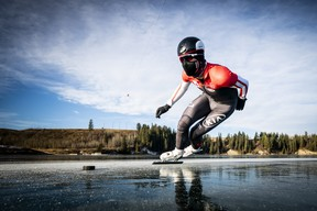 Speed skater Jordan Belchos rounds a tight turn while training on Ghost Lake near Cochrane, Alta., earlier in the winter.