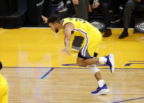 Stephen Curry celebrates after getting to 62 points against Portland.