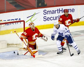 Calgary Flames goalie Jacob Markstrom is scored on by Toronto Maple Leafs Mitchell Marner in third period action at the Scotiabank Saddledome in Calgary on Tuesday, January 26, 2021.