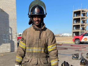Jamar Wall in firefighting gear during a boot camp in Crowley, Texas.