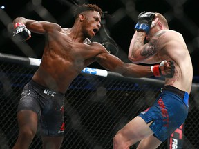 Hakeem Dawodu (left) fights Austin Arnett during UFC Fight Night at the Saddledome in Calgary on Saturday, July 28, 2018.