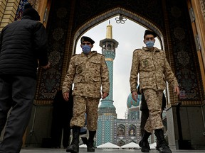 Iranian soldiers leave Imamzadeh Saleh shrine after Tehran reopened following a two-week shutdown, December 5, 2020.