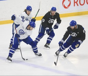 Toronto Maple Leafs John Tavares (91) cuts along the blue line and drops a pass through his legs to William Nylander RW (back) at practice in Toronto on Tuesday.