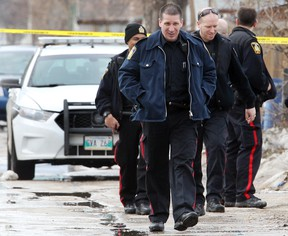 Winnipeg Police investigate after a male was shot in the 600 block of Manitoba Avenue in Winnipeg, Man. Monday, April 7, 2014.