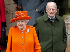 In this file photo taken on December 25, 2017 Britain's Queen Elizabeth II  and Prince Philip, Duke of Edinburgh, leave after attending the Royal Family's traditional Christmas Day church service at St Mary Magdalene Church.