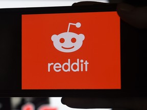 This photo illustration shows the logo of Reddit on a mobile phone in Arlington, Va. on Jan. 29, 2021.