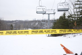 Yellow police tape at the ski and snowboard hill at Earl Bales Park. which is closed due to the COVID lockdown, on Tuesday January 5, 2021.