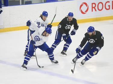 Toronto Maple Leafs John Tavares C (91) cuts along the blue line and drops a pass through his legs to William Nylander RW (88) at practice in Toronto on Tuesday January 12, 2021. Jack Boland/Toronto Sun/Postmedia Network