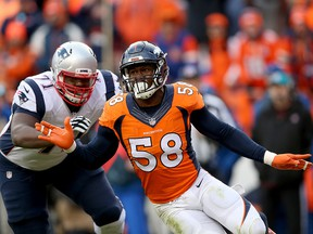 Von Miller of the Denver Broncos rushes against Cameron Fleming of the New England Patriots at Sports Authority Field at Mile High on January 24, 2016 in Denver.