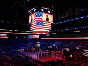 The Suns and Wizards stand during the U.S. National Anthem at Capital One Arena in Washington, D.C., Jan. 11, 2021.