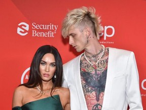 In this handout image courtesy of ABC rapper Machine Gun Kelly and actress Megan Fox arrive for the 2020 American Music Awards at the Microsoft theatre on November 22, 2020 in Los Angeles.