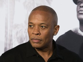 """In this file photo taken on August 10, 2015 rapper/producer Dr. Dre arrives for the Universal Pictures And Legendary Pictures premiere of """"Straight Outta Compton"""" in Los Angeles."""