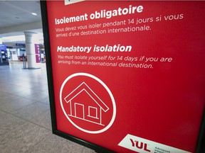A sign at Montreal's Trudeau airport reminds travellers about quarantine regulations.
