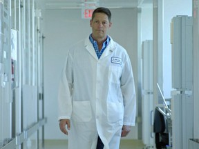 Owen Sound native John Lewis, the CEO of Entos Pharmaceuticals, walks to the lab.