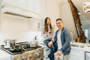 Chef Eric Chong and his fiancee Jen in their kitchen. SUPPLIED