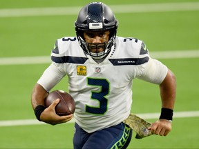 Quarterback Russell Wilson isn't happy with how many times he has been hit since he became a Seahawks.