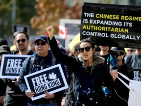 Supporters hold a rally in solidarity with Hong Kong protesters, in Vancouver, Sept. 29, 2019.