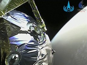 A view as Tianwen-1 probe enters the orbit of Mars in this screen grab obtained from a video on Feb. 12, 2021.