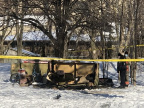 Toronto Police at the scene of a homeless encampment fire in Corktown on Wednesday, Feb. 17, 2021. A man was found dead.