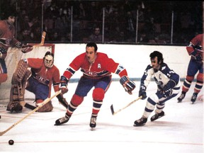 Frank Mahovlich in full flight for the Montreal Canadiens in 1971, with goalie Ken Dryden in the background.