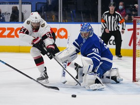 Ottawa Senators' Artem Anisimov (51) and Maple Leafs goaltender Frederik Andersen reach for a rebound during the second period at Scotiabank Arena on Wednesday, Feb. 18, 2021.