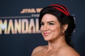 "In this file photo taken on Nov. 13, 2019, American actress Gina Carano arrives for the Disney+ World Premiere of The Mandalorian at El Capitan theatre in Hollywood. Carano has been dropped by Lucasfilm after sharing ""abhorrent"" social media posts on topics including the Holocaust."