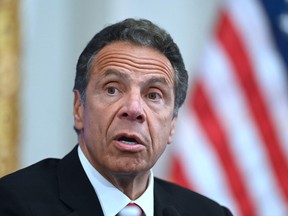 In this file photo Governor of New York Andrew Cuomo speaks during a press conference at the New York Stock Exchange (NYSE) on May 26, 2020 at Wall Street in New York City.