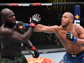 In this handout image provided by UFC, Ciryl Gane, right, of France punches Jairzinho Rozenstruik of Suriname in a heavyweight bout during the UFC Fight Night event at UFC APEX on Feb. 27, 2021 in Las Vegas, Nevada.