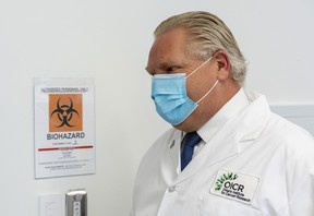 Premier Doug Ford tours a lab at the Ontario Institute for Cancer Research to see COVID-19 research in Toronto on Tuesday, February 23, 2021.