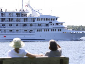 The cruise ship Pearl Mist makes its way upriver on the St. Lawrence as it passes Brockville, Ont., July 16, 2015.