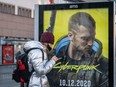 An advertisement of Cyberpunk 2077 game is seen on Dec. 4, 2020 before the expected release of Cyberpunk 2077 game, in Warsaw, Poland.