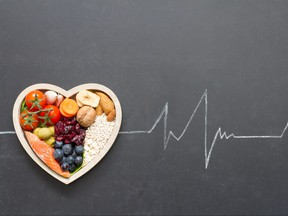 Healthy food in heart and cardiograph on blackboard medical abstract