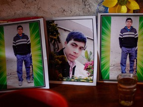 The portrait of Guatemalan migrant Rivaldo Danilo (16), believed to be among the 19 people killed in Mexico, is veiled at his house in Tuilelen village, Guatemala on January 28, 2021.