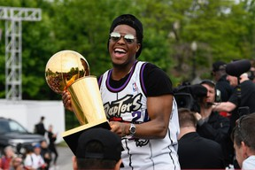 Toronto Raptors guard Kyle Lowry holds the Larry O'Brien Trophy during Raptors victory parade celebration in Toronto, Ontario, Canada, June 17, 2019.