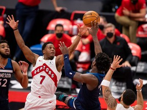 Toronto Raptors guard Kyle Lowry attempts to block Minnesota Timberwolves forward Anthony Edwards during the fourth quarter of a game between the Toronto Raptors and the Minnesota Timberwolves at Amalie Arena.