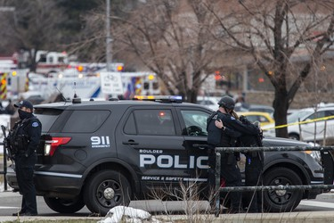 Two police officers embrace after a gunman opened fire at a King Soopers grocery store on March 22, 2021 in Boulder, Colorado. Dozens of police responded to the afternoon shooting in which at least one witness described three people who appeared to be wounded, according to published reports.  (Photo by Chet Strange/Getty Images)