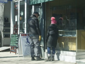 Window shoppers are pictured along Queen St. E. at a jewelry store in the Beaches on March 7, 2021.