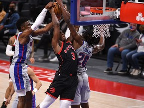 Raptors forward OG Anunoby (3) is fouled by Detroit Pistons centre Isaiah Stewart (28) during the fourth quarter at Little Caesars Arena on Tuesday.