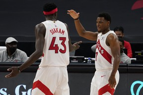 Toronto Raptors guard Kyle Lowry (7) celebrates with forward Pascal Siakam (43) as the pair is taken out of the game against the Denver Nuggets during the second half of an NBA basketball game Wednesday, March 24, 2021, in Tampa, Fla.