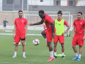 Canadian midfielder Ballou Tabla controls the ball as teammates look on during a training session at the CONCACAF Men's Olympic Qualifying tournament in Guadalajara, Mexico on March 18. 2021. Canada play Haiti in its second game on Monday, March. 22.