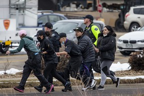 Shoppers are evacuated from a King Soopers grocery store after a gunman opened fire in Boulder, Colo., Monday, March 22, 2021.