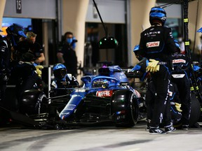 Fernando Alonso of Spain driving the Alpine A521 Renault stops in the Pitlane during the F1 Grand Prix of Bahrain at Bahrain International Circuit on March 28, 2021 in Bahrain, Bahrain.
